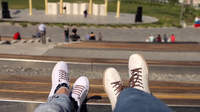 Feet resting couple on a bench of street theater | Shutterstock HD Video #1012832879