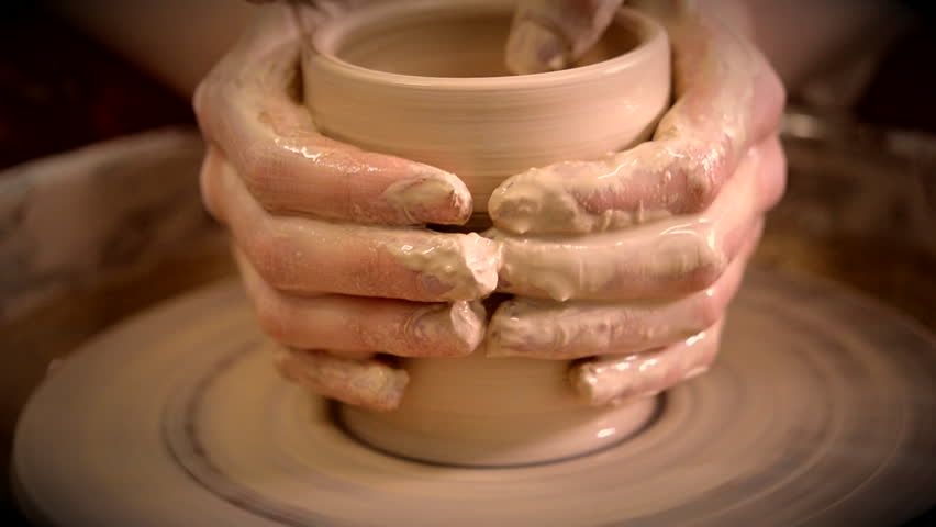 Creating vase of white clay close-up. The sculptor in workshop makes jug out of clay closeup. Twisted potter's wheel. Master crock. Potter's work close-up. Man hands making clay jug. Handmade. Craft. | Shutterstock HD Video #1012836014