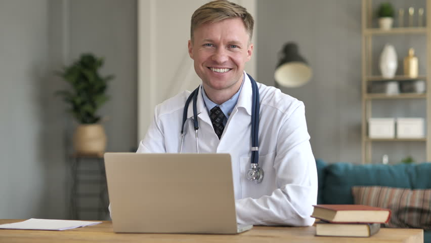 Smiling Positive Doctor At Work Looking at Camera | Shutterstock HD Video #1012843514