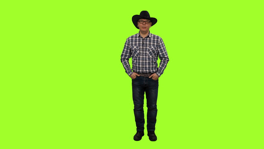 Middle-aged man in plaid shirt and cowboy hat speaking on green background, Front view, Chroma key, 4k shot