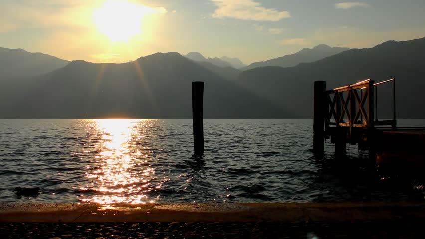 4K footage of the beautiful Lake Garda in Italy at sunset, as seen from Malcesine. Lake Garda (Italian: Lago di Garda) is the largest lake in Italy.