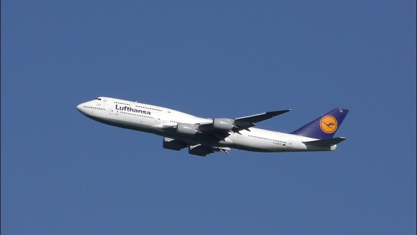 Lufthansa Airlines Boeing 747 jumbo jet climbs into blue sky after taking off, engine sound, Logan Airport Boston Massachusetts USA, June 26, 2018