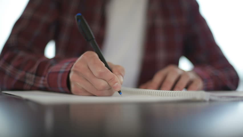 Close up of male hands taking notes in notebook | Shutterstock HD Video #1012873268
