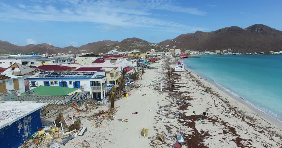 Hurricane Irma a category 5 storm completely destroyed the boardwalk  on st maarten and the businesses next to it. The entire boardwalk was turn into a beach.  | Shutterstock HD Video #1012906139