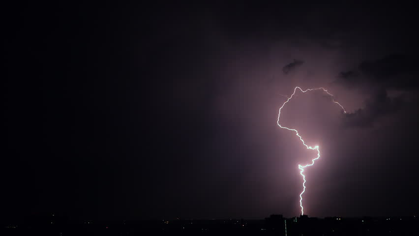Night stormy sky above city. Set of beautiful lightning strikes. Thunderstorm clouds. Timelapse. Slow motion. #1012907732