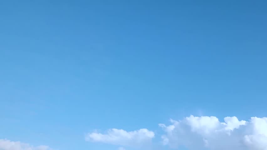 Beautiful white clouds and sky in time lapse, very nice clear blue soft skies background, real fast motion cloudscape. #1012940555