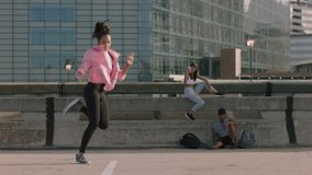 dancing woman young hip hop dancer performing freestyle moves multi ethnic friends watching enjoying urban dance practice using smartphone taking video sharing on social media