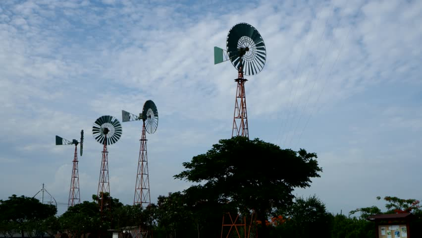 Wind turbine ,Cloud,sky Cloud, blue sky ,sky ,sunlight ,Shadow ,Light and shadow , rotate,environment ,loop , clean energy energy ,somersault ,aura , peace | Shutterstock HD Video #1012956299