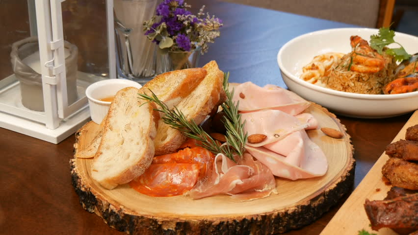 Ham and toast on a wooden tray. | Shutterstock HD Video #1012961171