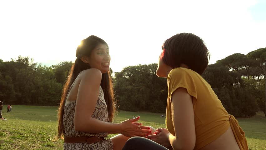 Feminine friendship, confidences and secrets- Happy girlfriends talking   Shutterstock HD Video #1012963841