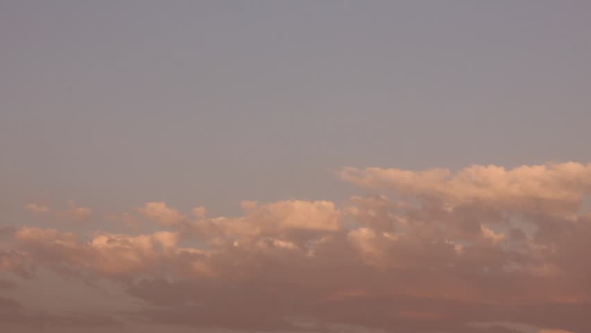 Sunset clouds, time lapse. Beautiful Flying over the Clouds with the evening (morning) Sun.  Cloud chenge colors in sunny day, orange,pink cloud, blue rain cloud in bad weather, FHD. #1012965773