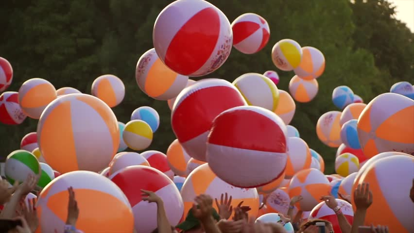 BUDAPEST, HUNGARY Festival Sziget 9 aug. 2017 - Aug. 16 2017 at a concert a crowd of people throws up a lot of beach balls, Slow motion, closeup