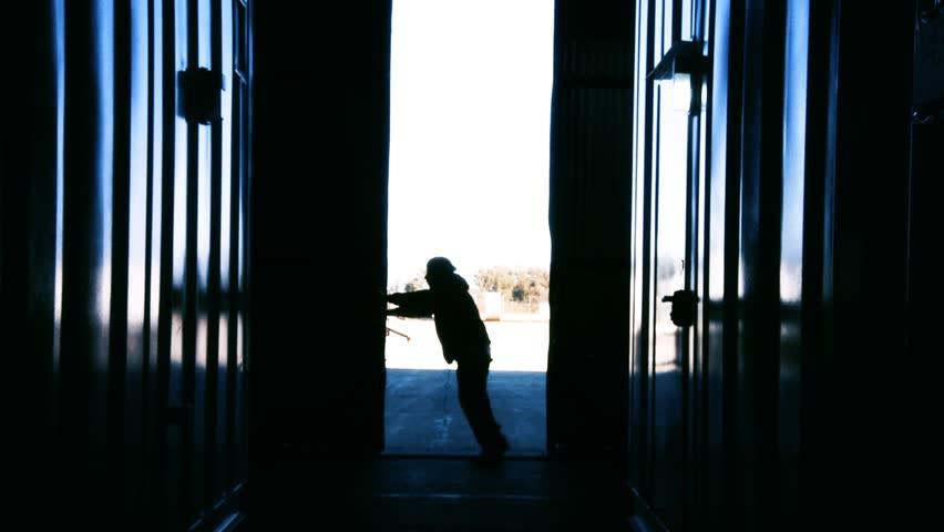 Warehouse Worker Opening Metal Door. Blue Steel Tone. Zoom In. | Shutterstock HD Video #1012979813