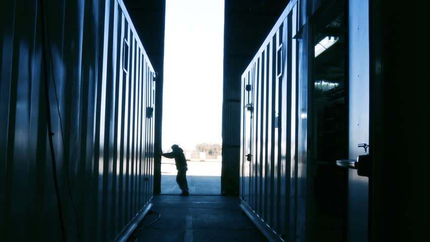 Worker opening the Gate in a Server Room or Data Center. Blue Steel Tone. Zoom Out. | Shutterstock HD Video #1012980476