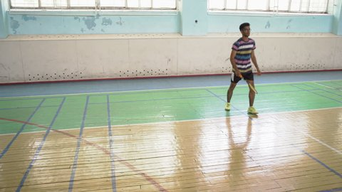 Indian Guy Play Badminton in the Sports Hall