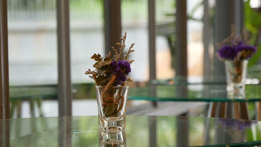 Flowers on glass table | Shutterstock HD Video #1012984169