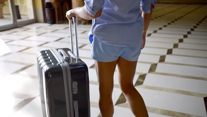woman leaving with luggage - 852×480