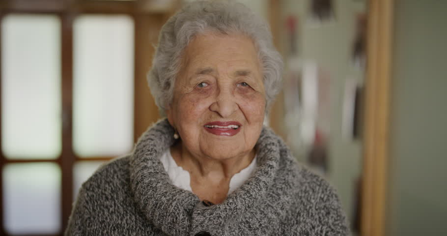 portrait of happy elderly woman laughing cheerful enjoying relaxed lifestyle in retirement home beautiful old lady smiling indoors retired carefree #1012995668