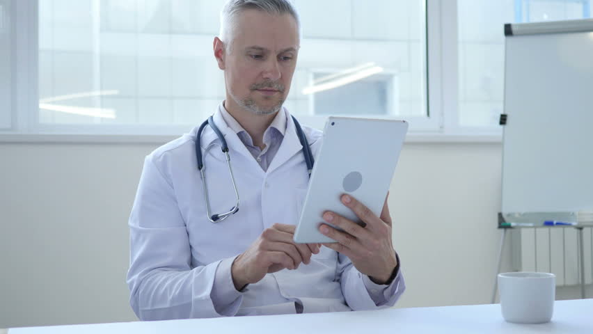 Online Video Chat on Tablet by Doctor   Shutterstock HD Video #1013000531