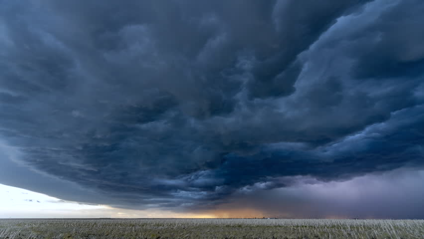 A timelapse of the center of a tornadic supercell shows the violent cloud structure and lightning needed to feed the cell, create a powerful inflow and ultimately form a tornado. | Shutterstock HD Video #1013016935