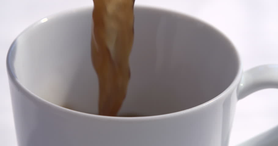 Slow motion coffee being poured into coffee mug | Shutterstock HD Video #1013027102