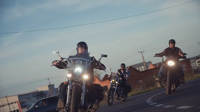A lot of subculture bikers group ride on the track on a Sunny summer day on custom motorcycles, a large-scale action of motorcyclists. a passion for traveling by a group of men   Shutterstock HD Video #1013034590