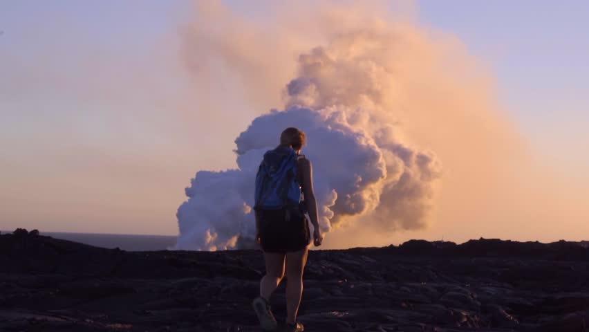 Woman Walking towards Erupting Kilauea Volcano in Hawaii
