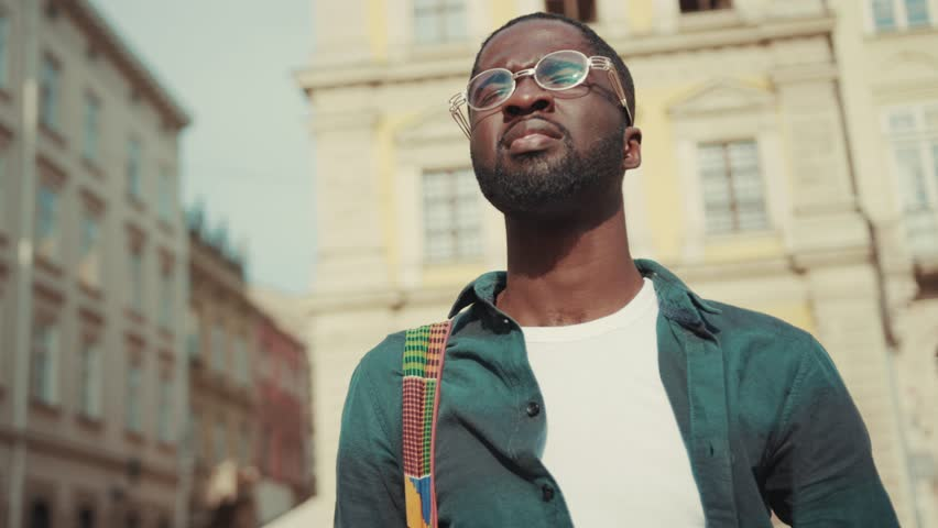 NEW YORK - April 5, 2017: African american young man happy tourist taking photo on his camera travelling in Europe face technology handsome street urban black portrait afro close up individuality | Shutterstock HD Video #1013038478