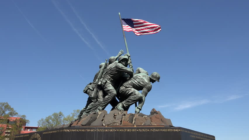 WASHINGTON, DC - APR 2015: Iwo Jima Memorial Marine Corp flag Washington DC 4K. Entrance to Arlington National Cemetery. Over 400,000 graves in cemetery. Dedicated to United States Marine Corps.