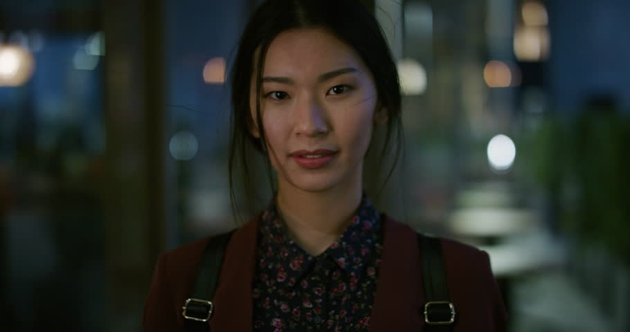 Portrait successful young asian business woman student smiling enjoying professional lifestyle beautiful independent female in late urban evening slow motion real people series