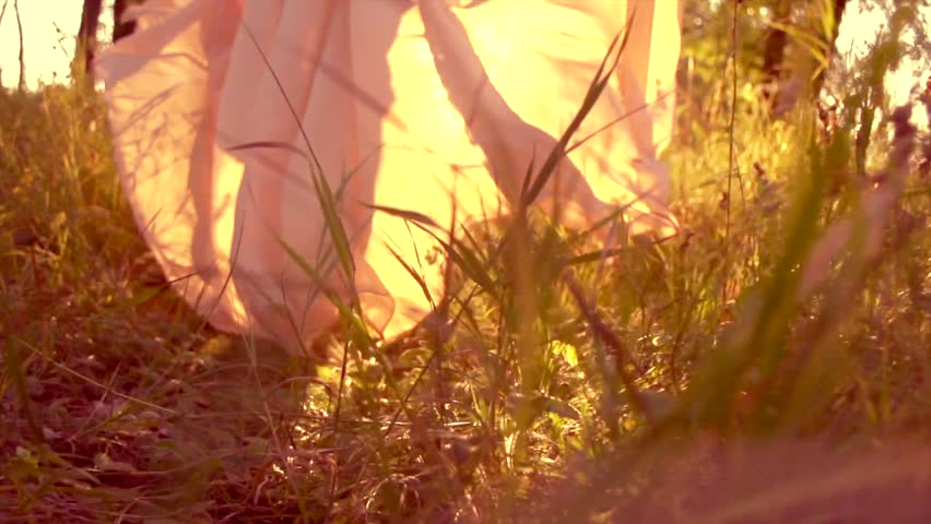 Beauty romantic young woman in long chiffon dress with gown running in the forest on sunset. Beautiful happy bride model girl enjoying nature outdoors. Slow motion 240 fps. High speed camera 4K UHD #1013079878