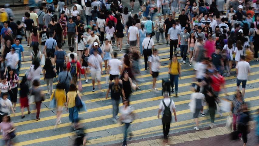 Time lapse of crowd of people walking crossing street at a busy intersection. | Shutterstock HD Video #1013088077