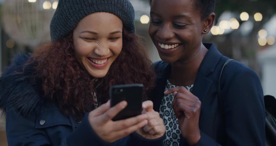 Portrait of beautiful young women friends taking selfie #1013089181