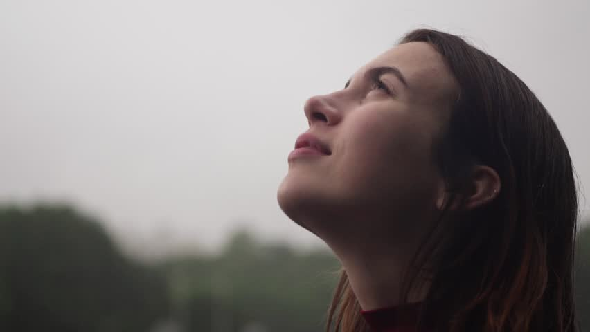 Close-up face of young happy sensual woman with wet hair looking up at rain enjoying and smiling, slow motion | Shutterstock HD Video #1013100536