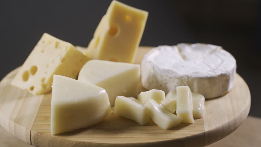 Pieces of different cheeses on plate   Shutterstock HD Video #1013103872