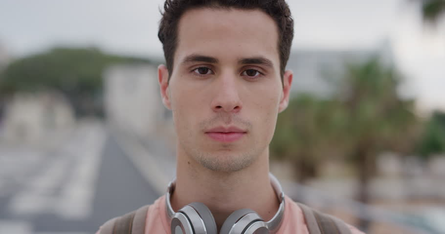 Close up portrait attractive young hispanic man student smiling enjoying successful vacation lifestyle relaxed male in urban city slow motion | Shutterstock HD Video #1013107085