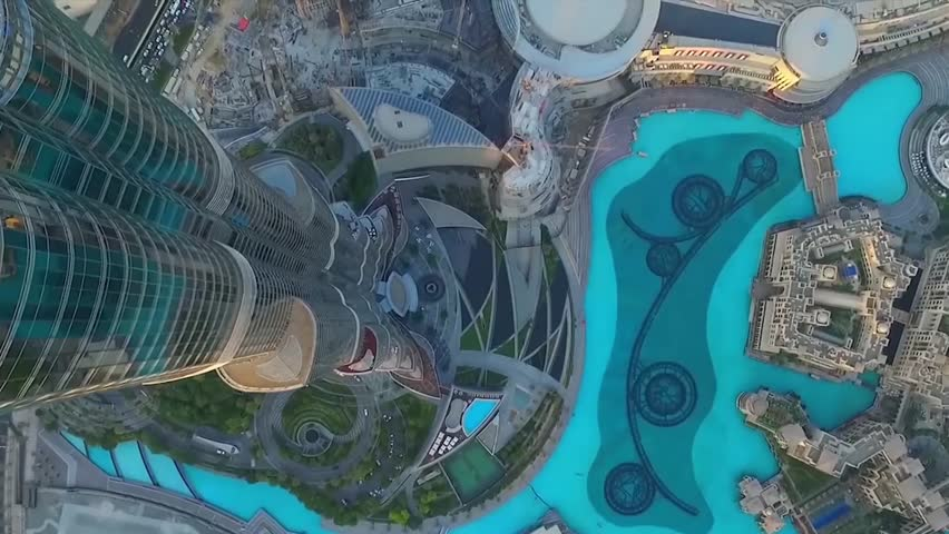 Dubai, UAE - May 25, 2018: Dubai Fountain as seen from Burj Khalifa, Dubai United Arab Emirates. Stock. Top view of dubai downtown and fountains from the top of burj khalifa