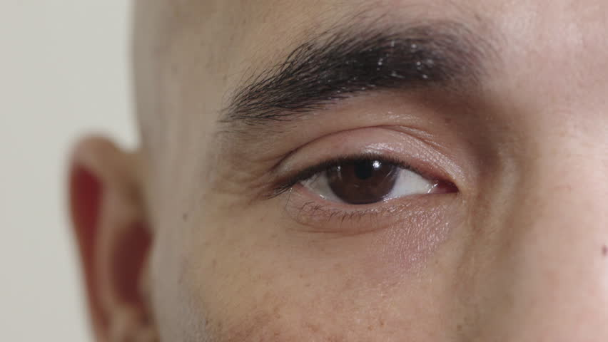 Close up of hispanic man eye looking at camera blinking contemplative reflection vision eyesight optical health   Shutterstock HD Video #1013137301