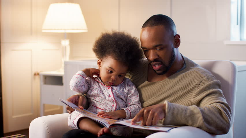 Father Reading Book To Young Son At Home In Nursery #1013146493