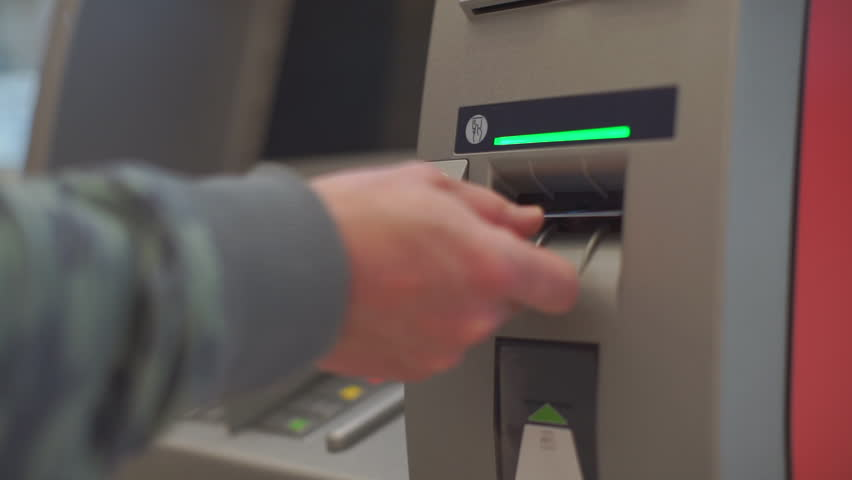 Credit card entry to ATM hand uses bank card. Getting cash in a safe way. Financial security and banking system concept. Operation with electronic money. Royalty-Free Stock Footage #1013160926