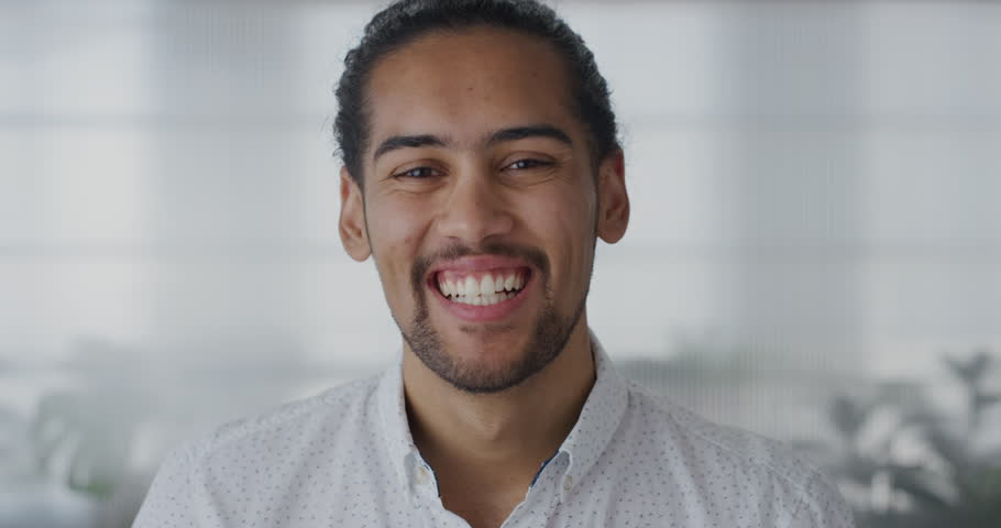 Close up portrait attractive young hispanic entrepreneur man laughing enjoying professional career success slow motion wearing white shirt | Shutterstock HD Video #1013161667
