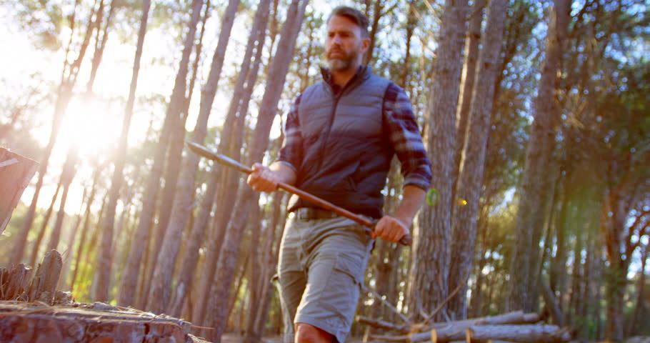 Caucasian male logger chopping wood with an axe in the forest on a sunny day 4k | Shutterstock HD Video #1013162003