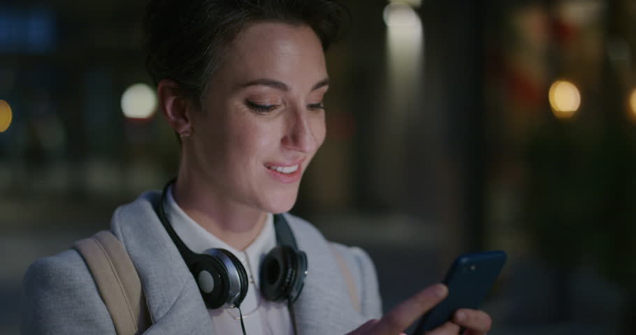 Portrait stylish young business woman using smartphone texting browsing messages online enjoying checking emails in relaxed urban evening smiling satisfaction slow motion | Shutterstock HD Video #1013162102