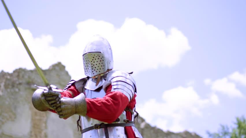 Male in armor, medieval warrior preparing for battle, historical reenactment | Shutterstock HD Video #1013186417