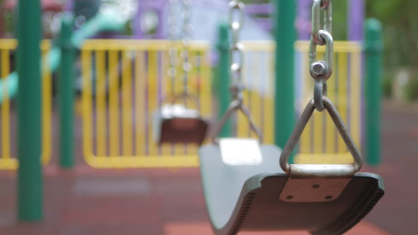 Empty Children's swing in the playground | Shutterstock HD Video #1013191112