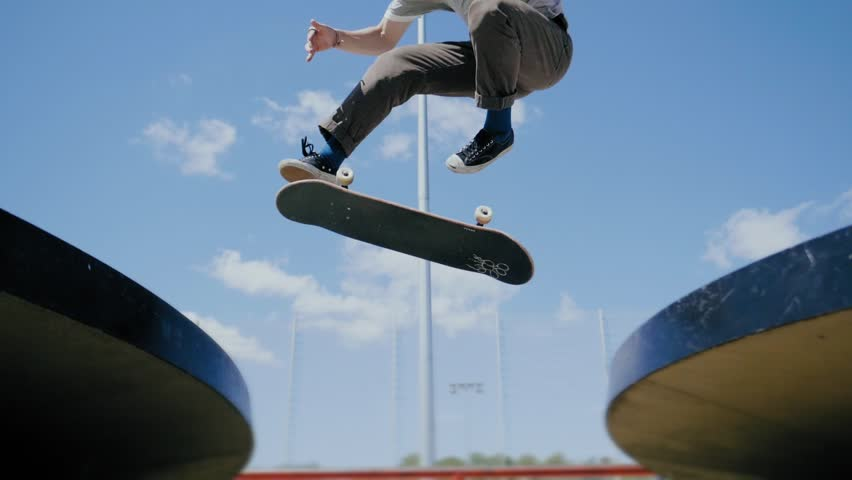 Young skater doing tricks outdoors. Slowmotion video 150fps | Shutterstock HD Video #1013194154