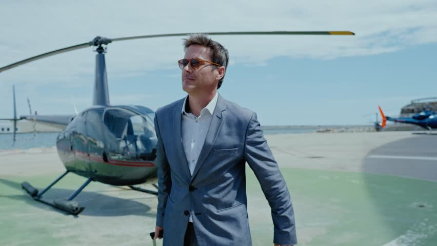 Businessman waiting near private helicopter Royalty-Free Stock Footage #1013194181