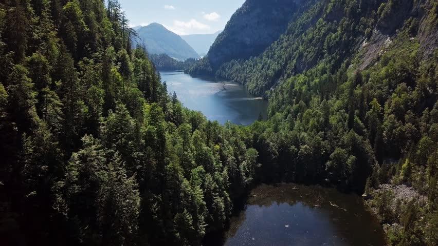 Flight over Toplitzsee (Toplitz lake) and Kammersee mountain lakes, in Salzkammergut, Styria, Austria.