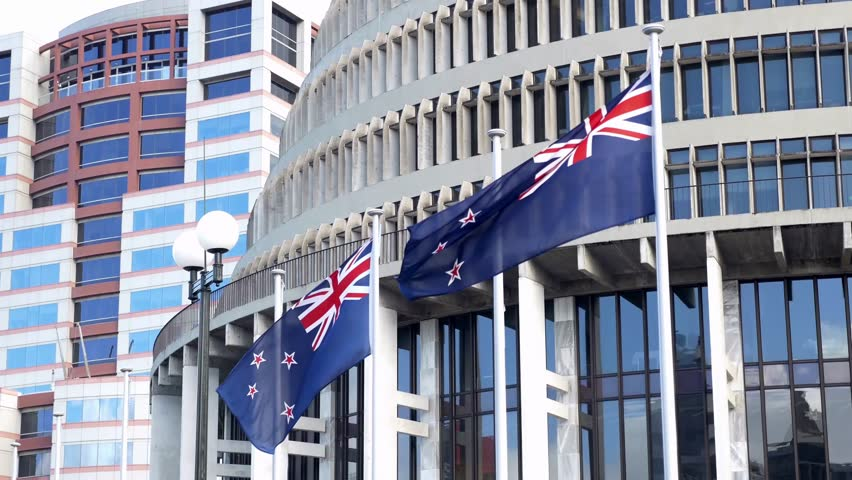 New Zealand flags flying outside the 'Beehive' , the Executive Wing of the New Zealand Parliament Buildings in Wellington, New Zealand