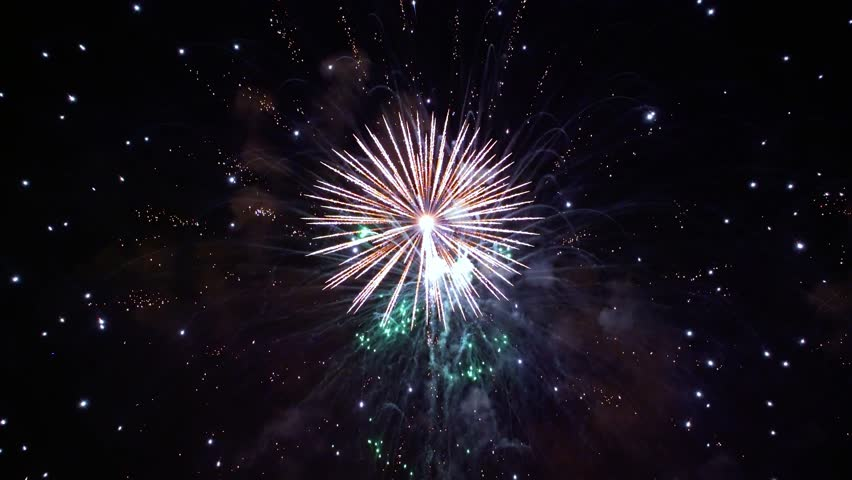 Colorful fireworks exploding in the night sky. Celebrations and events in bright colors.   Shutterstock HD Video #1013231828